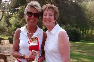 Ladies' Captain Mel Gregory presents the St George's Fantasy prize to Lulu Wood.