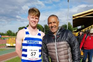 Kieran Gillespie poses for a picture with Olympic decathlete Daley Thompson.