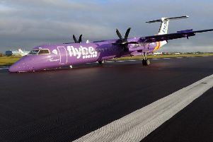 The plane on the runway at Belfast International Airport.
