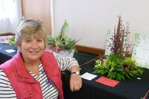 Pauline Curtis  with her winning foliage arrangement, which also took Best in Show. EMN-190617-141758001