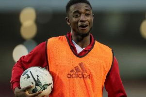 Derry City's Junior Ogedi-Uzokwe celebrates with the match ball, after scoring a hat-trick at Turner's Cross.