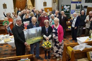 Alan and Lynda Saxton receive their gifts and good wishes from Canon Robinson, Val Waddington and parishioners EMN-190107-083017001