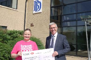 Emily Beahan  receives the cheque from Bulley Davey director, Mitchell Burden.