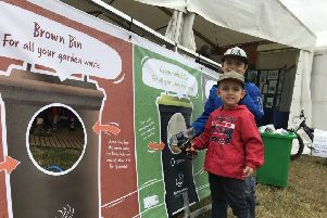 Learning to recycle right on the NKDC stand. EMN-190723-170306001