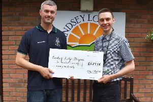 Stuart Smith of Brigg Hockey Club (left) is pictured with Hospice Fundraising Assistant Daniel Redhead EMN-190808-101421001
