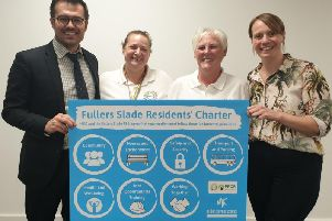 Cllr Hannah ONeil (Deputy Leader), right, and Rob Middleton (Cabinet Member for Finance and Resources), left, flanking members of the Fullers Slade Residents Steering Group