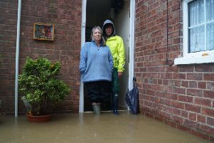 Yvonne Horrocks, left, and Julie Lambie from MRAG at the entrance to the Willingham Road house which has flooded EMN-190811-174656001