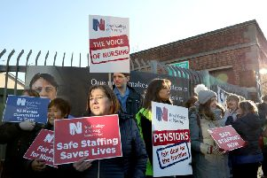 Nurses gathered at the gates of the Royal Victoria Hospital in Belfast as part of their industrial action in protest at pay and unsafe staffing levels