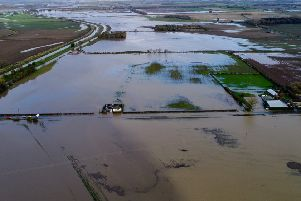 The flooded A631 road and many acres of farmland at Bishopbridge. Picture: Julian Anyan