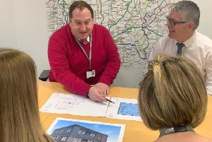 Councillor Giles McNeil - centre -  looking at the depot plans. EMN-200128-092227001
