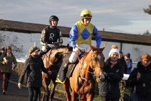 McFabulous (left), with Harry Cobden on board, follows second-placed Hometown Boy and Cieran Gethings into the winners' enclosure. Picture: Peter Thompson EMN-201002-113315002