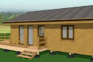 An artists impression of what the holiday lodges could look like. EMN-200601-094735001