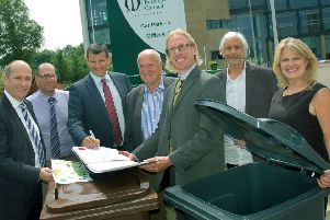 Melton Council leader, Councillor Joe Orson, and chief executive, Edd de Coverly, with officials from Biffa, at the signing of the borough's new waste contract EMN-180806-124901001