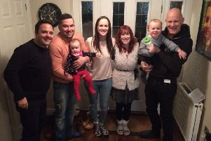Ray Walker (right) with wife Vanessa, his three children and two grandchildren EMN-180511-155211001