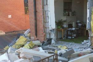The demolished frontage of a house in Nottingham Road, Melton, after a car ploughed into it EMN-181113-125353001