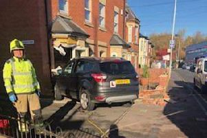 A car pictured embedded in the front of a house on Nottingham Road, Melton, following Tuesday's accident EMN-181114-155224001