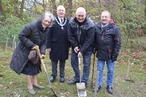 Senior Townwarden, John Southerington (centre), watches the presidents of Melton's three Rotary clubs, start planting more than 100 trees in Priors Close park EMN-181126-145654001