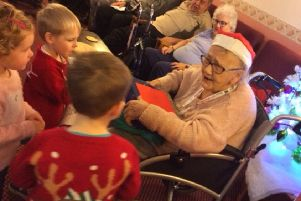 Children from Asfordby Pre-school give presents to the residents of Bradgate Flats PHOTO: Supplied
