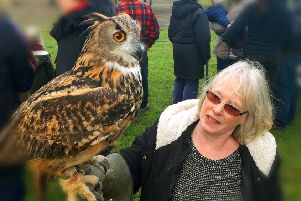 Sandra Watson with her eagle owl pictured at Tuesday's annual New Year hunt meet in Melton EMN-190201-093021001