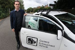 Councillor Blake Pain with the camera enforcement vehicle being used by Leicestershire County Council to clamp down on motorists who park irresponsibly outside schools EMN-190901-145421001