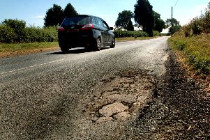 A pot-holed stretch of the road leading into Long Clawson which Leicestershire County Council was due to investigate prior to carrying out extensive repairs following complaints by motorists EMN-190121-164628001
