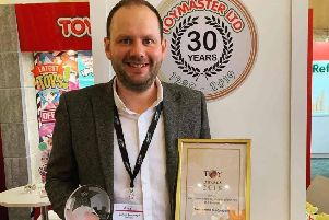 Melton Toymaster owner James Colclough with the award for being named best independent toy retailer at the National Toy Awards EMN-190123-142625001