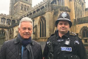 Melton MP Sir Alan Duncan pictured with Sgt Iain Wakelam, of Melton Police, outside St Mary's Church in the town this morning, as they discussed concerns over rising crime EMN-190125-135039001