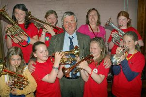Brownlow Primary School teacher Fred Parker pictured with some of his brass instrument pupils and one of his former pupils, fellow teacher Kirsten Smith, on his retirement day in July 2013'PHOTO: Tim Williams EMN-190802-182209001