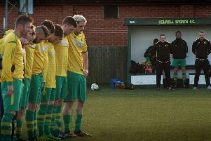 Holwell Sports players line up for a minute's silence for Ian Wakefield ahead of Saturday's match with Aylestone Park EMN-191202-100358002