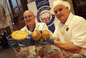 Phil Walmsley, from Nice Pie, and Paul Hartland, of  Mrs King's Pork Pies, prepare to start judging in the 2019 British Pie Awards in Melton EMN-190603-115543001