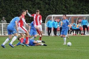 Brackley Town's Jimmy Armson is thwarted against Stockport County. Photo: Jake McNulty