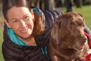 Julie Thomas and her pet Dolly, a five-year-old chocolate labrador who is helping bereaved Melton people cope with their loss EMN-191103-175508001