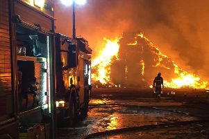 Firefighters tackle a huge stacks blaze involving straw and tyres at Saltby EMN-190320-090939001