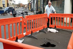 54A King Street cafe owner Nigel Keep next to the sinkhole which appeared close to his business EMN-190318-151630001