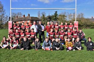 Leicestershire Rugby Union president Steve Rice is pictured presenting the RFU Accreditation documents to Melton RFC club president Tony Middleton and safeguarding officer Andrew Thorpe, with the Under 15s and some of the newly-formed girls' section in support EMN-190326-122228002