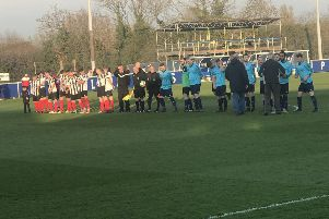 Wymeswold FC Reserves (in blue) and Cosby line up before kick-off. Picture: Leicestershire and Rutland FA EMN-190404-144030002