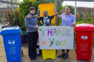 Staff Viv Durham and Precious Obilaso with Preston Shumba, who is supported by Rainbows, along with bins Barry, Betty and Bertie PHOTO: Supplied