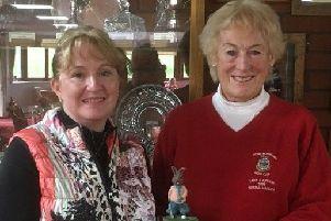 Lady captain Karen Rawson is presented with the Rabbit Trophy by lady president Norma Varley EMN-190904-103037002