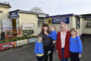 Pictured at Groarty Integrated Primary School, which is facing closure, are from left, Haiden McLaughlin, Diana McLaughlin, Arianna McLaughlin, Leanne Brown and Oisin Brown. DER1519-131KM