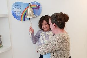 Evie Moore, with mum Helena Isaac, rings the bell at Sheffield Children's Hospital to celebrate being given the all-clear from leukaemia EMN-190418-185157001