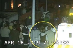 An image taken from the C.C.T.V. issued by the P.S.N.I. which show Lyra McKee moments before a masked gunman opened fire.