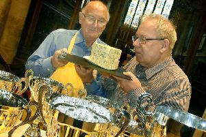 Ian Neale (left) and organiser Matthew O'Callaghan check out one of the entries for the 2019 Artisan Cheese Awards at Melton's St Mary's Church EMN-190425-161303001