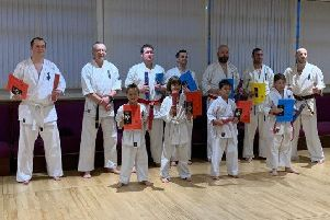 The successful Ronin Kyokushin Karate Club students with new belts EMN-190513-084057002