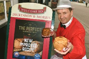 Managing director, Stephen Hallam, shows off the revamped Dickinson and Morris Melton Mowbray pork pie outside Ye Olde Pork Pie Shoppe in Nottingham Street, Melton EMN-190520-161428001