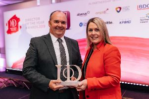 Alan Lowry, managing director of ESF,  receiving the 'Innovation Director of the Year'  award from Ashleen Feeney, director at KPMG, category sponsor.