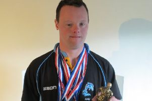 Andy, with his East Midlands overall champion trophy, first swam for GB aged 21 EMN-190529-125811002