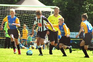 Under 12s winners Mowbray Rangers (yellow and blue) take on French visitors Etoile at last year's festival EMN-190406-184135002