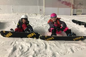 Luca Aspart and Iris McCarthy during their free birthday snowboard lesson at The Snow Centre in Hemel Hempstead recently.