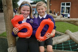 Year 3 pupils Mabel and Charlie celebrate the 50th anniversary of their school, Sherard Primary School being opened EMN-190619-104735001