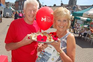 Derek Simmonds and Jenny Barnes promote the Melton Centenary Trail in aid of Birch Wood Area Special School at the town's Paint The Town Red event on Sunday EMN-190621-091622001